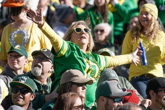 Dec 31, 2018; Santa Clara, CA, USA; Oregon Ducks fan celebrates against the Michigan State Spartans during the second quarter at Levi's Stadium. Mandatory Credit: Stan Szeto-USA TODAY Sports