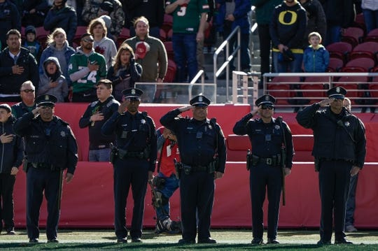 Dec 31, 2018; Santa Clara, CA, USA; Police Officers salute during the singing of the National Anthem before the game between the Oregon Ducks and the Michigan State Spartans at Levi's Stadium. Mandatory Credit: Stan Szeto-USA TODAY Sports