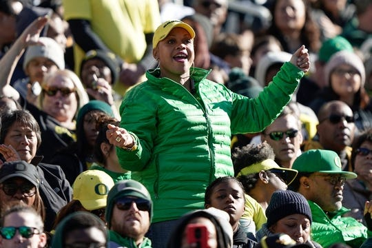 Dec 31, 2018; Santa Clara, CA, USA; Oregon Ducks fan dances to music from the band in the game against the Michigan State Spartans during the first quarter at Levi's Stadium. Mandatory Credit: Stan Szeto-USA TODAY Sports