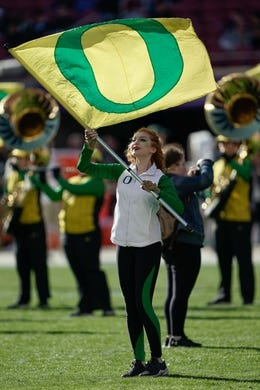 Dec 31, 2018; Santa Clara, CA, USA; Oregon Ducks cheerleader performs with the band before the game against the Michigan State Spartans at Levi's Stadium. Mandatory Credit: Stan Szeto-USA TODAY Sports