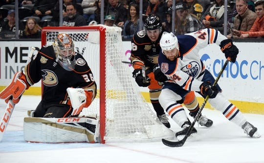 January 6, 2019; Anaheim, CA, USA; Edmonton Oilers right wing Zack Kassian (44) moves in for a shot on goal against Anaheim Ducks defenseman Josh Mahura (76) and goaltender John Gibson (36) during the first period at Honda Center. Mandatory Credit: Gary A. Vasquez-USA TODAY Sports