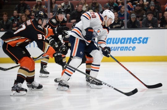 January 6, 2019; Anaheim, CA, USA; Edmonton Oilers center Leon Draisaitl (29) moves the puck ahead of Anaheim Ducks left wing Nick Ritchie (37) and right wing Daniel Sprong (11) during the first period at Honda Center. Mandatory Credit: Gary A. Vasquez-USA TODAY Sports