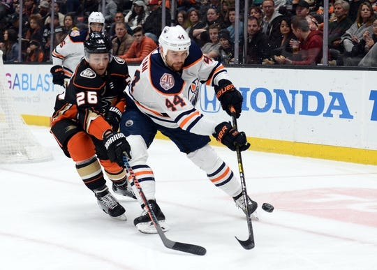 January 6, 2019; Anaheim, CA, USA; Edmonton Oilers right wing Zack Kassian (44) moves the puck against Anaheim Ducks defenseman Brandon Montour (26) during the first period at Honda Center. Mandatory Credit: Gary A. Vasquez-USA TODAY Sports