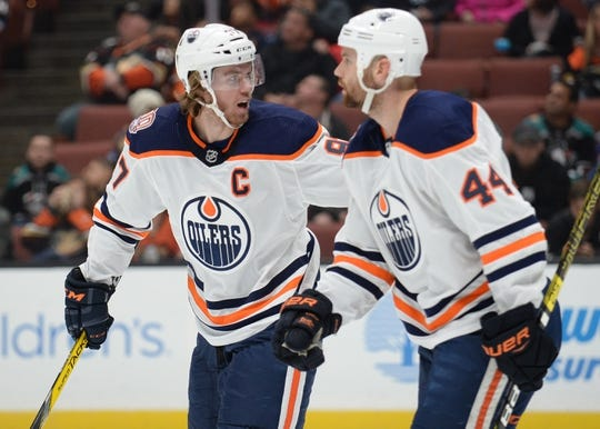 January 6, 2019; Anaheim, CA, USA; Edmonton Oilers center Connor McDavid (97) celebrates with right wing Zack Kassian (44) his goal scored against the Anaheim Ducks during the first period at Honda Center. Kassian provided an assist on the goal. Mandatory Credit: Gary A. Vasquez-USA TODAY Sports