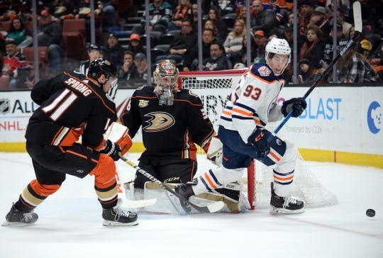 January 6, 2019; Anaheim, CA, USA; Anaheim Ducks right wing Daniel Sprong (11) helps goaltender John Gibson (36) defend the goal against Edmonton Oilers center Ryan Nugent-Hopkins (93) during the first period at Honda Center. Mandatory Credit: Gary A. Vasquez-USA TODAY Sports