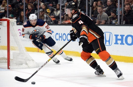 January 6, 2019; Anaheim, CA, USA; Anaheim Ducks defenseman Cam Fowler (4) controls the puck as Edmonton Oilers center Leon Draisaitl (29) moves in during the first period at Honda Center. Mandatory Credit: Gary A. Vasquez-USA TODAY Sports