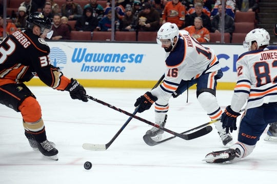 January 6, 2019; Anaheim, CA, USA; Edmonton Oilers left wing Jujhar Khaira (16) defends against Anaheim Ducks right wing Jakob Silfverberg (33) during the second period at Honda Center. Mandatory Credit: Gary A. Vasquez-USA TODAY Sports