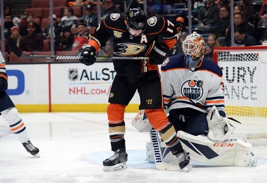 January 6, 2019; Anaheim, CA, USA; Edmonton Oilers goaltender Cam Talbot (33) blocks a shot as Anaheim Ducks center Ryan Kesler (17) is in position for the rebound during the second period at Honda Center. Mandatory Credit: Gary A. Vasquez-USA TODAY Sports