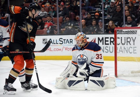 January 6, 2019; Anaheim, CA, USA; Edmonton Oilers goaltender Cam Talbot (33) blocks a shot as Anaheim Ducks left wing Nick Ritchie (37) moves in on goal during the second period at Honda Center. Mandatory Credit: Gary A. Vasquez-USA TODAY Sports