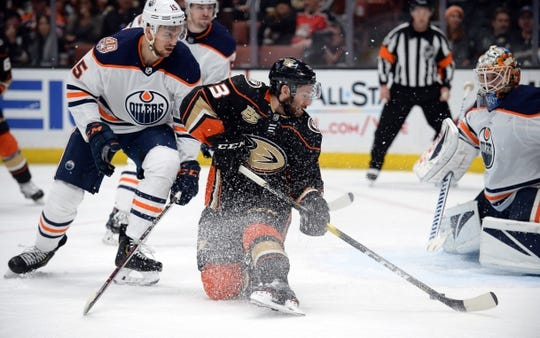 January 6, 2019; Anaheim, CA, USA; Anaheim Ducks center Brian Gibbons (23) moves in for a shot on goal against Edmonton Oilers goaltender Cam Talbot (33) and defenseman Alexander Petrovic (15) during the second period at Honda Center. Mandatory Credit: Gary A. Vasquez-USA TODAY Sports