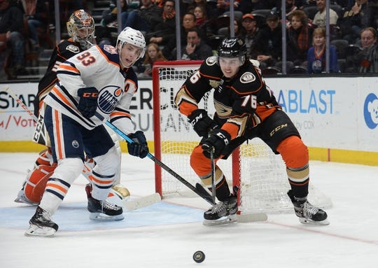 January 6, 2019; Anaheim, CA, USA; Anaheim Ducks defenseman Josh Mahura (76) clears the puck away as Edmonton Oilers center Ryan Nugent-Hopkins (93) moves in during the third period at Honda Center. Mandatory Credit: Gary A. Vasquez-USA TODAY Sports