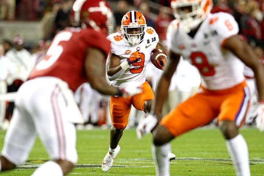 Jan 7, 2019; Santa Clara, CA, USA; Clemson Tigers running back Travis Etienne (9) runs for a touchdown during the first quarter against the Alabama Crimson Tide during the 2019 College Football Playoff Championship game at Levi's Stadium. Mandatory Credit: Matthew Emmons-USA TODAY Sports