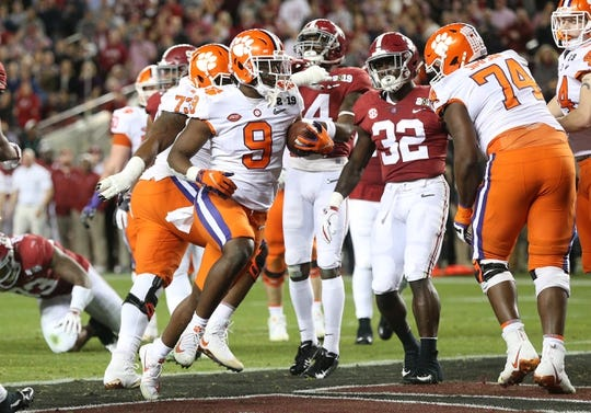 Jan 7, 2019; Santa Clara, CA, USA; Clemson Tigers running back Travis Etienne (9) scores a touchdown in the second quarter against the Alabama Crimson Tide during the 2019 College Football Playoff Championship game at Levi's Stadium. Mandatory Credit: Cary Edmondson-USA TODAY Sports