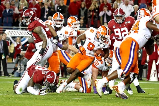 Jan 7, 2019; Santa Clara, CA, USA; Clemson Tigers running back Travis Etienne (9) runs for a touchdown during the second quarter against the Alabama Crimson Tide during the 2019 College Football Playoff Championship game at Levi's Stadium. Mandatory Credit: Matthew Emmons-USA TODAY Sports