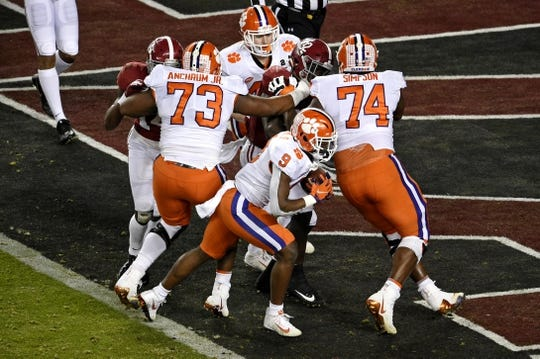 Jan 7, 2019; Santa Clara, CA, USA; Clemson Tigers running back Travis Etienne (9) runs for a touchdown during the second quarter against the Alabama Crimson Tide during the 2019 College Football Playoff Championship game at Levi's Stadium. Mandatory Credit: Kelvin Kuo-USA TODAY Sports