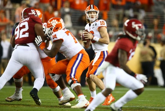 Jan 7, 2019; Santa Clara, CA, USA; Clemson Tigers quarterback Trevor Lawrence (16) drops back to pass against the Alabama Crimson Tide in the second quarter during the 2019 College Football Playoff Championship game at Levi's Stadium. Mandatory Credit: Mark Rebilas-USA TODAY Sports