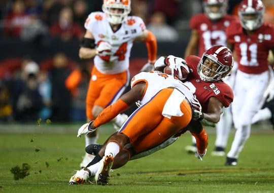 Jan 7, 2019; Santa Clara, CA, USA; Alabama Crimson Tide running back Josh Jacobs (8) is tackled by Clemson Tigers defensive back K'Von Wallace (12) in the second quarter during the 2019 College Football Playoff Championship game at Levi's Stadium. Mandatory Credit: Mark Rebilas-USA TODAY Sports