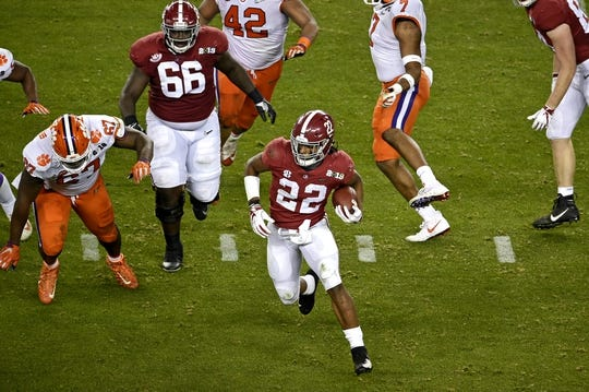 Jan 7, 2019; Santa Clara, CA, USA; Alabama Crimson Tide running back Najee Harris (22) runs the ball against Clemson Tigers defensive tackle Albert Huggins (67) during the first half during the 2019 College Football Playoff Championship game at Levi's Stadium. Mandatory Credit: Kelvin Kuo-USA TODAY Sports