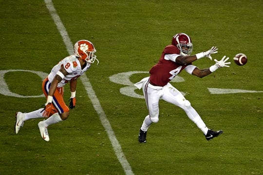 Jan 7, 2019; Santa Clara, CA, USA; Alabama Crimson Tide wide receiver Jerry Jeudy (4) catches a pass against Clemson Tigers cornerback A.J. Terrell (8) during the first half during the 2019 College Football Playoff Championship game at Levi's Stadium. Mandatory Credit: Kelvin Kuo-USA TODAY Sports