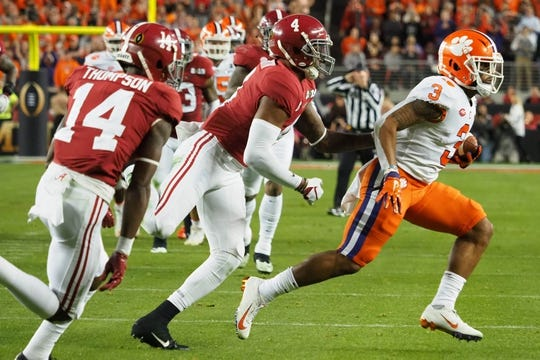 Jan 7, 2019; Santa Clara, CA, USA; Clemson Tigers wide receiver Amari Rodgers (3) runs the ball ahead of Alabama Crimson Tide defensive back Saivion Smith (4) during the second quarter in the 2019 College Football Playoff Championship game at Levi's Stadium. Mandatory Credit: Kelley L Cox-USA TODAY Sports