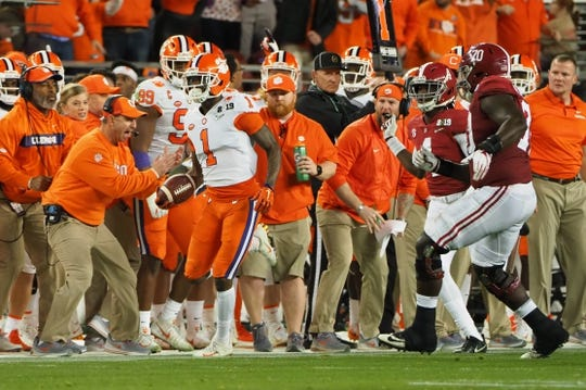 Jan 7, 2019; Santa Clara, CA, USA; Clemson Tigers wide receiver Trevion Thompson (1) runs the ball past head coach Dabo Swinney and ahead of Alabama Crimson Tide defensive back Saivion Smith (4) and offensive lineman Alex Leatherwood (70) during the second quarter in the 2019 College Football Playoff Championship game at Levi's Stadium. Mandatory Credit: Kelley L Cox-USA TODAY Sports
