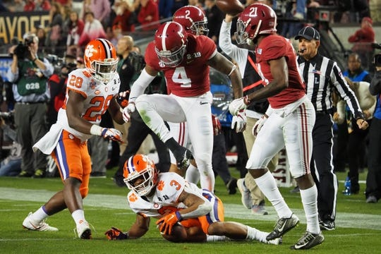 Jan 7, 2019; Santa Clara, CA, USA; Alabama Crimson Tide defensive back Saivion Smith (4) steps over Clemson Tigers wide receiver Amari Rodgers (3) during the second quarter in the 2019 College Football Playoff Championship game at Levi's Stadium. Mandatory Credit: Kelley L Cox-USA TODAY Sports