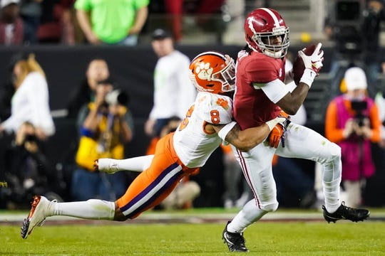 Jan 7, 2019; Santa Clara, CA, USA; Alabama Crimson Tide wide receiver Jerry Jeudy (4) runs the ball as Clemson Tigers cornerback A.J. Terrell (8) defends during the second quarter in the 2019 College Football Playoff Championship game at Levi's Stadium. Mandatory Credit: Kyle Terada-USA TODAY Sports