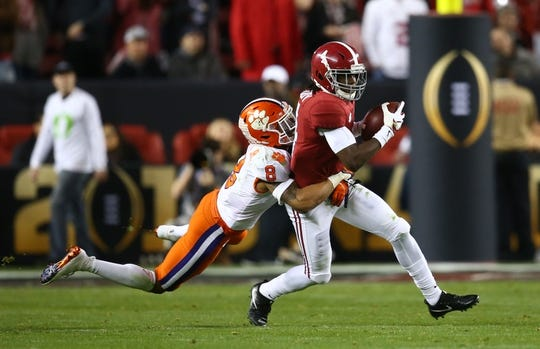 Jan 7, 2019; Santa Clara, CA, USA; Alabama Crimson Tide wide receiver Jerry Jeudy (4) is tackled by Clemson Tigers cornerback A.J. Terrell (8) in the second quarter during the 2019 College Football Playoff Championship game at Levi's Stadium. Mandatory Credit: Mark Rebilas-USA TODAY Sports