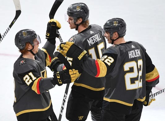 Jan 8, 2019; Las Vegas, NV, USA; Vegas Golden Knights center Cody Eakin (21) is congratulated by defenseman Nick Holden (22) and defenseman Jon Merrill (15) after scoring a first period goal against the New York Rangers at T-Mobile Arena. Mandatory Credit: Stephen R. Sylvanie-USA TODAY Sports