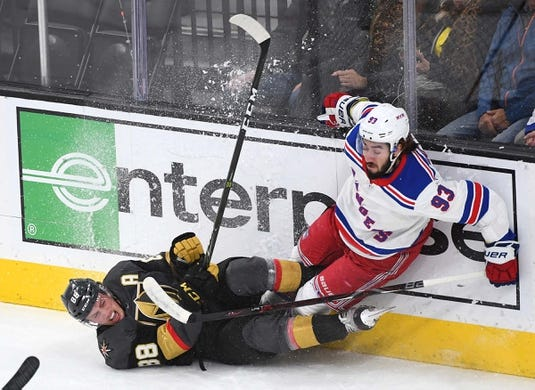 Jan 8, 2019; Las Vegas, NV, USA; Vegas Golden Knights defenseman Nate Schmidt (88) collides with New York Rangers center Mika Zibanejad (93) during the first period at T-Mobile Arena. Mandatory Credit: Stephen R. Sylvanie-USA TODAY Sports