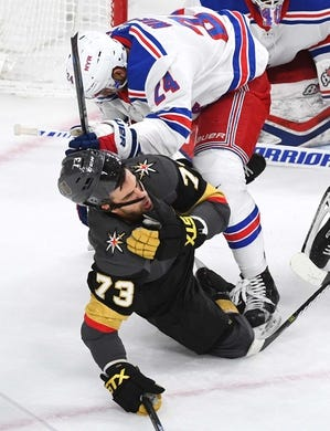 Jan 8, 2019; Las Vegas, NV, USA; New York Rangers center Boo Nieves (24) throws Vegas Golden Knights center Brandon Pirri (73) to the ice during the first period at T-Mobile Arena. Mandatory Credit: Stephen R. Sylvanie-USA TODAY Sports