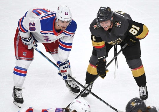 Jan 8, 2019; Las Vegas, NV, USA; New York Rangers left wing Chris Kreider (20) talks to Vegas Golden Knights center Jonathan Marchessault (81) before a first period face off at T-Mobile Arena. Mandatory Credit: Stephen R. Sylvanie-USA TODAY Sports