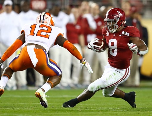 Jan 7, 2019; Santa Clara, CA, USA; Alabama Crimson Tide running back Josh Jacobs (8) runs with the ball against Clemson Tigers  safety K'von Wallace (12) during the 2019 College Football Playoff Championship game at Levi's Stadium. Mandatory Credit: Matthew Emmons-USA TODAY Sports