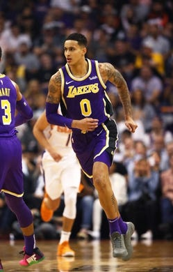 Oct 24, 2018; Phoenix, AZ, USA; Los Angeles Lakers forward Kyle Kuzma (0) against the Phoenix Suns at Talking Stick Resort Arena. Mandatory Credit: Mark J. Rebilas-USA TODAY Sports