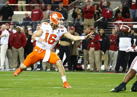 Jan 7, 2019; Santa Clara, CA, USA; Clemson Tigers quarterback Trevor Lawrence (16) tosses a shovel pass against the Alabama Crimson Tide in the 2019 College Football Playoff Championship game at Levi's Stadium. Mandatory Credit: Matthew Emmons-USA TODAY Sports