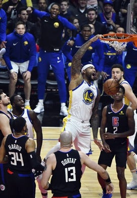 Jan 18, 2019; Los Angeles, CA, USA; Golden State Warriors center DeMarcus Cousins (0) throws down a one-handed slam dunk in the first quarter against the Los Angeles Clippers at Staples Center. Mandatory Credit: Robert Hanashiro-USA TODAY Sports
