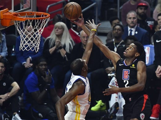 Jan 18, 2019; Los Angeles, CA, USA; Los Angeles Clippers guard Shai Gilgeous-Alexander (2) puts up a shot past Golden State Warriors forward Kevin Durant (35) during the first quarter at Staples Center. Mandatory Credit: Robert Hanashiro-USA TODAY Sports