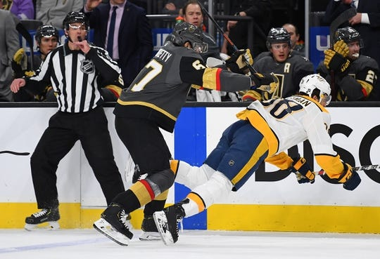 Jan 23, 2019; Las Vegas, NV, USA; Vegas Golden Knights left wing Max Pacioretty (67) checks Nashville Predators right wing Ryan Hartman (38) during the first period at T-Mobile Arena. Mandatory Credit: Stephen R. Sylvanie-USA TODAY Sports