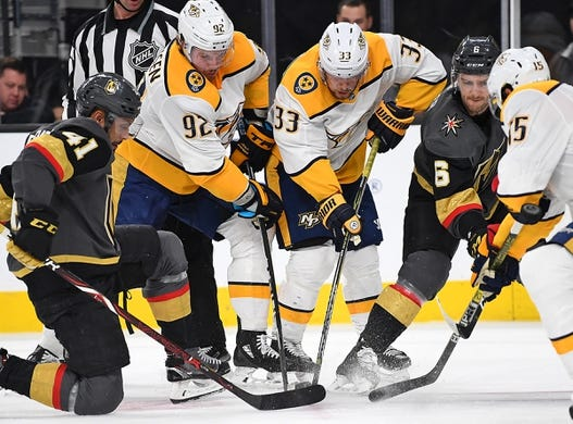 Jan 23, 2019; Las Vegas, NV, USA; Nashville Predators and the Vegas Golden Knights players battle for the puck during the first period at T-Mobile Arena. Mandatory Credit: Stephen R. Sylvanie-USA TODAY Sports