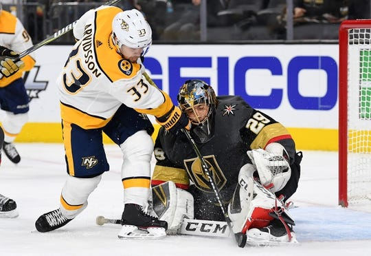 Jan 23, 2019; Las Vegas, NV, USA; Nashville Predators right wing Viktor Arvidsson (33) battles for the puck with Vegas Golden Knights goaltender Marc-Andre Fleury (29) during the first period at T-Mobile Arena. Mandatory Credit: Stephen R. Sylvanie-USA TODAY Sports