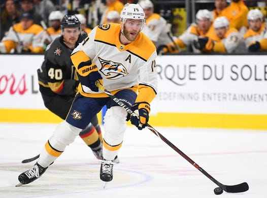 Jan 23, 2019; Las Vegas, NV, USA; Nashville Predators defenseman Mattias Ekholm (14) skates with the puck during the first period against the Vegas Golden Knights at T-Mobile Arena. Mandatory Credit: Stephen R. Sylvanie-USA TODAY Sports