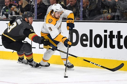 Jan 23, 2019; Las Vegas, NV, USA; Nashville Predators left wing Filip Forsberg (9) skates with the puck as Vegas Golden Knights defenseman Brayden McNabb (3) defends during the first period at T-Mobile Arena. Mandatory Credit: Stephen R. Sylvanie-USA TODAY Sports