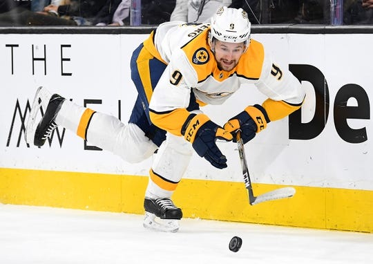 Jan 23, 2019; Las Vegas, NV, USA; Nashville Predators left wing Filip Forsberg (9) holds his balance while chasing a rolling puck during the first period against the Vegas Golden Knights at T-Mobile Arena. Mandatory Credit: Stephen R. Sylvanie-USA TODAY Sports