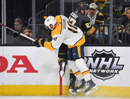 Jan 23, 2019; Las Vegas, NV, USA; Nashville Predators center Colton Sissons (10) checks Vegas Golden Knights defenseman Shea Theodore (27) during the first period at T-Mobile Arena. Mandatory Credit: Stephen R. Sylvanie-USA TODAY Sports