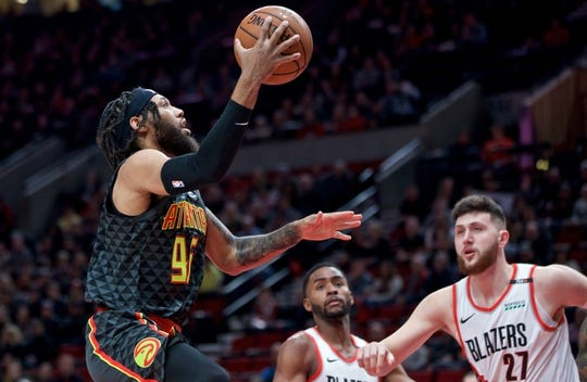 Jan. 26, 2019; Portland, OR, USA; Atlanta Hawks forward DeAndre' Bembry (95) shoots over Portland Trail Blazers center Jusuf Nurkic (27) and forward Maurice Harkless (4) during the first quarter at the Moda Center. Mandatory Credit: Craig Mitchelldyer-USA TODAY Sports