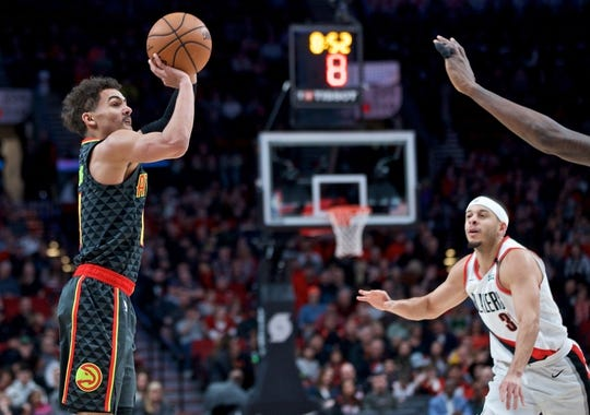 Jan. 26, 2019; Portland, OR, USA; Atlanta Hawks guard Trae Young (11) shoots over Portland Trail Blazers guard Seth Curry (31) during the first quarter at the Moda Center. Mandatory Credit: Craig Mitchelldyer-USA TODAY Sports