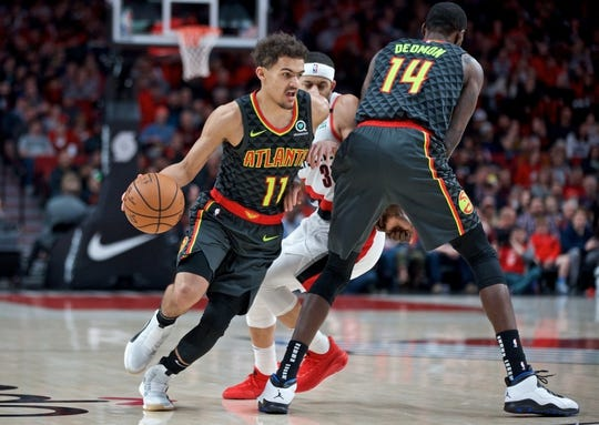 Jan. 26, 2019; Portland, OR, USA; Atlanta Hawks guard Trae Young (11) dribbles past Portland Trail Blazers guard Seth Curry (31) during the first quarter at the Moda Center. Mandatory Credit: Craig Mitchelldyer-USA TODAY Sports