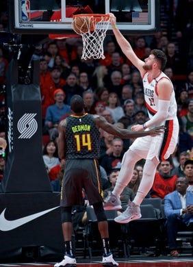 Jan. 26, 2019; Portland, OR, USA; Portland Trail Blazers center Jusuf Nurkic (27) dunks over Atlanta Hawks center Dewayne Dedmon (14) during the first quarter at the Moda Center. Mandatory Credit: Craig Mitchelldyer-USA TODAY Sports