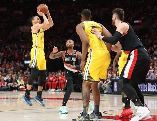 Feb 13, 2019; Portland, OR, USA;  Golden State Warriors guard Stephen Curry (30) shoots over Portland Trail Blazers guard Damian Lillard (0) in the first half at Moda Center. Mandatory Credit: Jaime Valdez-USA TODAY Sports