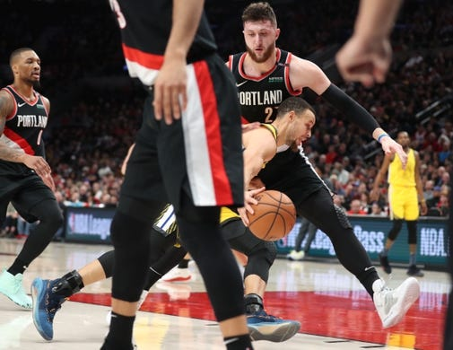 Feb 13, 2019; Portland, OR, USA; Golden State Warriors guard Stephen Curry (30) drives on Portland Trail Blazers center Jusuf Nurkic (27) in the first half at Moda Center. Mandatory Credit: Jaime Valdez-USA TODAY Sports